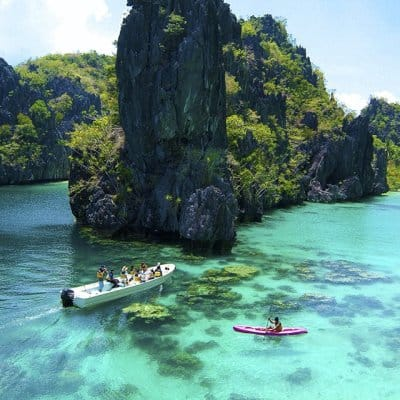 Island hop from El Nido to Coron in Palawan, Philippines and explore hundreds of untouched, paradise beach islands. Kitesurfing, snorkeling, diving.
