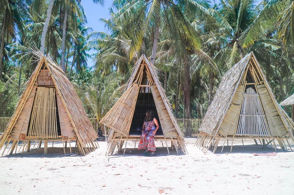 El Nido to Coron Island Hopping Boat Tours natural huts and living