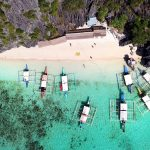 Multi-day party boat tour expedition between El Nido and Coron